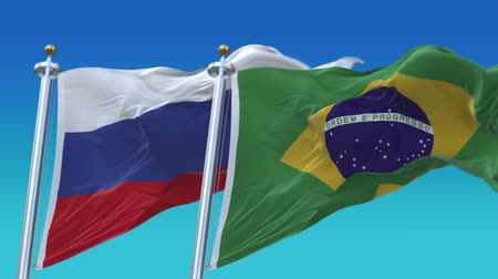 marş : 4k Seamless Brazil and Russia Flags with blue sky background,A fully digital rendering,The animation loops at 20 seconds,BRA BR RUS RU. Stok Video