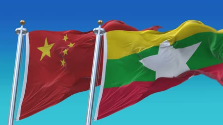 marş : 4k Seamless Myanmar and China Flags with blue sky background,A fully digital rendering,The animation loops at 20 seconds,MYA CN.
