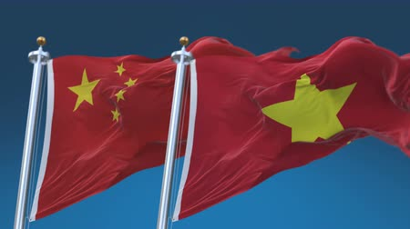 demokratický : 4k Seamless Vietnam and China Flags with blue sky background,A fully digital rendering,The animation loops at 20 seconds,VIE VN CHN CN.