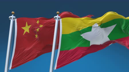 demokratický : 4k Seamless Myanmar and China Flags with blue sky background,A fully digital rendering,The animation loops at 20 seconds,MYA CN.