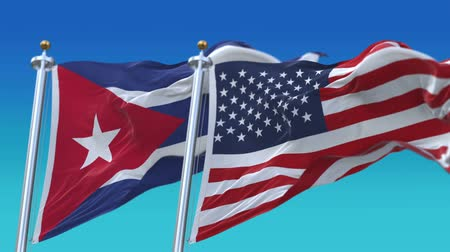 tédio : 4k Seamless United States of America And Cuba Flags with blue sky background,A fully digital rendering,The flag 3D animation loops at 20 seconds,USA US CUB CU.