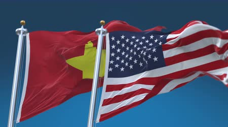 4k Seamless United States of America And Vietnam Flags with blue sky background,A fully digital rendering,The flag 3D animation loops at 20 seconds,USA US VIE VN. Stock Footage