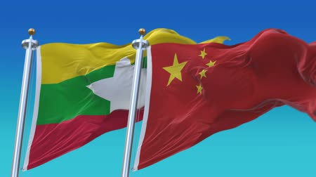 4k Seamless Myanmar and China Flags with blue sky background,A fully digital rendering,The animation loops at 20 seconds,MYA CN.