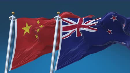 4k Seamless New Zealand and China Flags with blue sky background,A fully digital rendering,The animation loops at 20 seconds,NZL NZ CHN CN. Stock Footage