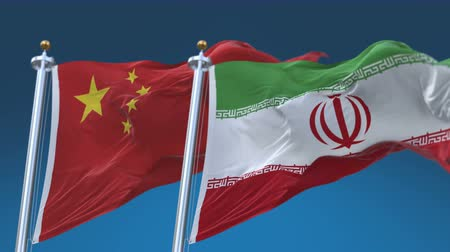 4k Seamless Iran and China Flags with blue sky background,A fully digital rendering,The animation loops at 20 seconds,IRI IR CHN CN.