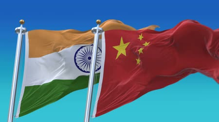 marş : 4k Seamless India and China Flags with blue sky background,A fully digital rendering,The animation loops at 20 seconds,IND IN CHN CN. Stok Video