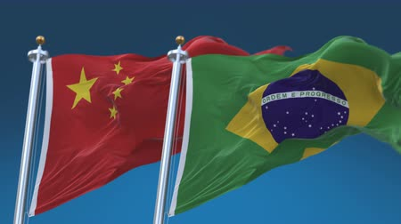 4k Seamless Brazil and China Flags with blue sky background,A fully digital rendering,The animation loops at 20 seconds,BRA BR CHN CN.