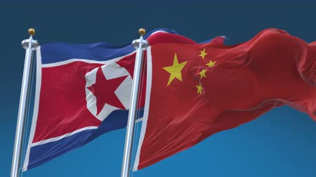 marş : 4k Seamless North Korea and China Flags with blue sky background,A fully digital rendering,The animation loops at 20 seconds,DPRK CHN CN. Stok Video