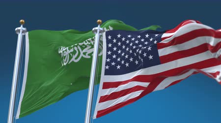 yumuşaklık : 4k Seamless United States of America And Saudi Arabia Flags with blue sky background,A fully digKSAl rendering,The flag 3D animation loops at 20 seconds,USA KSA. Stok Video