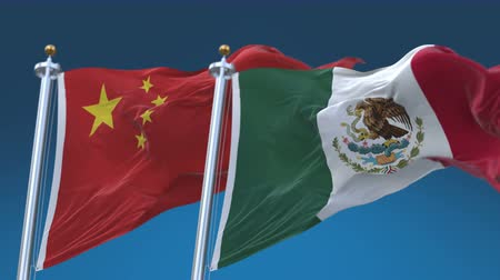 tédio : 4k Seamless Mexico and China Flags with blue sky background, A fully digital rendering, The animation loops at 20 seconds Stock Footage