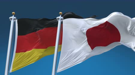 symbolic : 4k Seamless Germany and Japan Flags with blue sky background, A fully digital rendering, The animation loops at 20 seconds