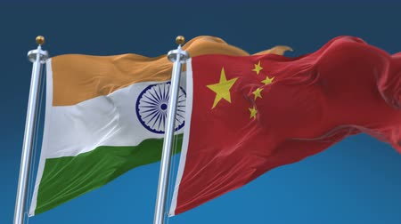 секунды : 4k Seamless India and China Flags with blue sky background, A fully digital rendering, The animation loops at 20 seconds