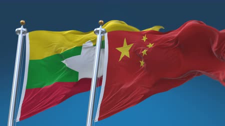 tédio : 4k Seamless Myanmar and China Flags with blue sky background, A fully digital rendering, The animation loops at 20 seconds