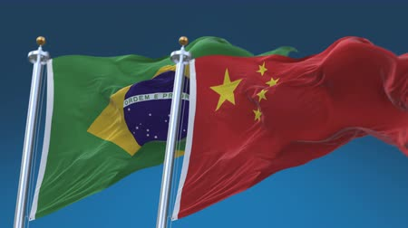 marş : 4k Seamless Brazil and China Flags with blue sky background, A fully digital rendering, The animation loops at 20 seconds