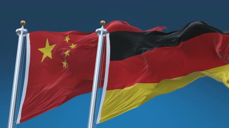 tédio : 4k Seamless Germany and China Flags with blue sky background, A fully digital rendering, The animation loops at 20 seconds Stock Footage