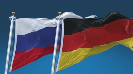 tédio : 4k Seamless Germany and Russia Flags with blue sky background, A fully digital rendering, The animation loops at 20 seconds