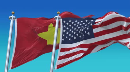 marş : 4k Seamless United States of America And Vietnam Flags with blue sky background,A fully digital rendering,The flag 3D animation loops at 20 seconds Stok Video