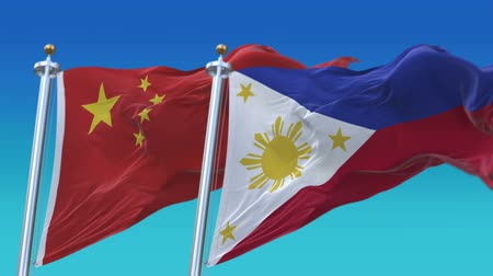tédio : 4k Seamless Philippines and China Flags with blue sky background, A fully digital rendering, The animation loops at 20 seconds Stock Footage
