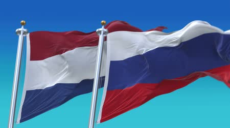 demokratický : 4k Seamless Netherlands Holland and Russia Flags with blue sky background,A fully digital rendering,The animation loops at 20 seconds