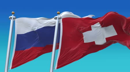 symbolic : 4k Seamless Switzerland and Russia Flags with blue sky background,A fully digital rendering,The animation loops at 20 seconds
