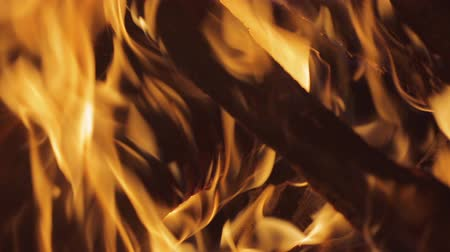 выброс : The wood burn in the fireplace. Heat and powerful flame. Close up view. Shot with Red Cinema Camera