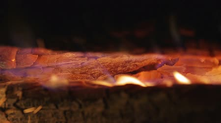 выброс : The wood burn in the fireplace. Heat and powerful flame. Slow motion capture. Close up view. Shot with Red Cinema Camera