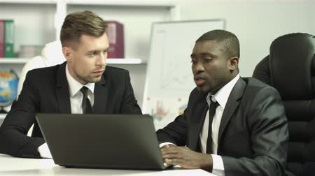 conference centre : The two businessmen discuss the project drawing on the laptop screen. Shot with Red Cinema Camera Stock Footage
