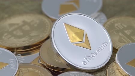 4K Physical metal silver Ethereum currency rotating over others coins. Worldwide virtual internet money. Digital Etherum coin cyberspace, cryptocurrency ETH. Good investment future online-Dan