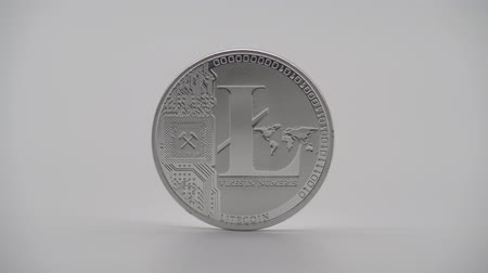 dançarinos : 4K Physical metal silver Litecoin currency on white background. New worldwide virtual internet money. Digital coin in cyberspace, cryptocurrency LTC. Good investment for future of online payment-Dan