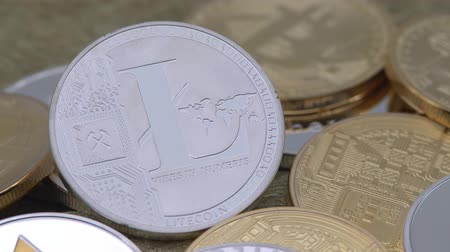 4K Physical metal silver Litecoin currency over others coins. New worldwide virtual internet money. Digital coin in cyberspace, cryptocurrency LTC. Good investment for the future of online payment-Dan