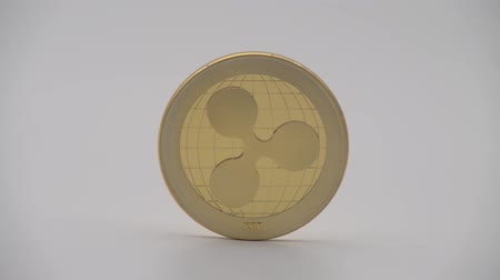 gondoskodó : 4K Physical metal golden Ripplecoin currency on white background. New worldwide virtual internet money. Digital Ripple coin cyberspace, cryptocurrency XRP. Good investment future online-Dan Stock mozgókép