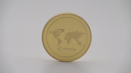 4K Physical metal golden Ripplecoin currency on white background. New worldwide virtual internet money. Digital Ripple coin cyberspace, cryptocurrency XRP. Good investment future online-Dan Стоковые видеозаписи