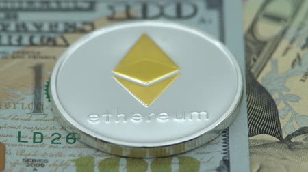 4K Physical metal silver Ethereum currency over 100 dollar bill of United States. Worldwide virtual internet money with USA banknotes. Digital coin cyberspace, cryptocurrency ETH. Online payment-Dan