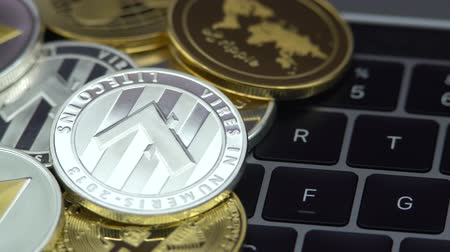 4K Physical metal silver Litecoin currency on notebook computer keyboard. New worldwide virtual internet money. Digital coin cyberspace, cryptocurrency LTC. Good investment future online-Dan