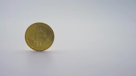 4K Physical metal golden Bitcoin currency on white background. New worldwide virtual internet money. Digital coin in cyberspace, cryptocurrency gold BTC. Good investment future of online payment-Dan