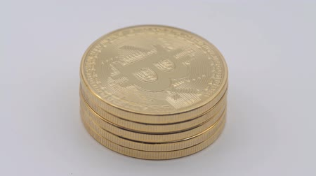 4K Physical metal golden Bitcoin currency rotating on white background. New worldwide virtual internet money. Digital coin cyberspace cryptocurrency gold BTC. Good investment future online-Dan 動画素材