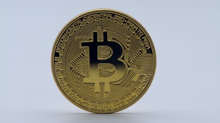 gondoskodó : 4K Physical metal golden Bitcoin currency on white background. New worldwide virtual internet money. Digital coin in cyberspace, cryptocurrency gold BTC. Good investment future of online payment-Dan