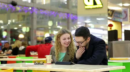 phablet : Young Couple are Using Tablet PC in Coffee Shop Stock Footage