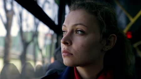 автобус : Young woman traveling by bus on a sunny day