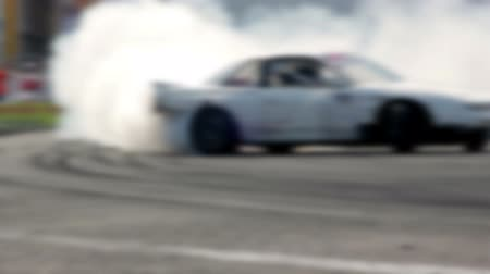 andarilho : Drift car racing on the asphalt track. A lot of smoke. Blur.