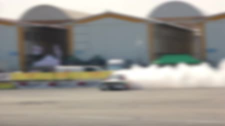 дрейф : Drift car racing on the asphalt track. A lot of smoke. Blur.