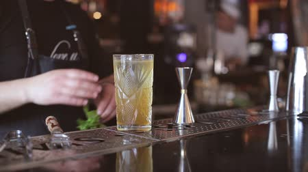 straining : Barthender makes cocktails at the bar Stock Footage