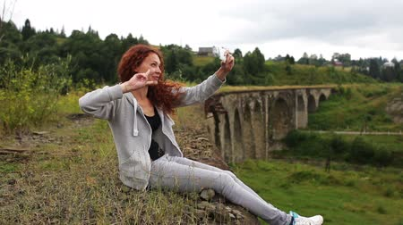 bridge man made structure : Girl doing selfie sitting on the old viaduct