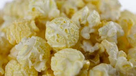 full bucket : Salt popcorn in box on white background, rotation, very close up Stock Footage