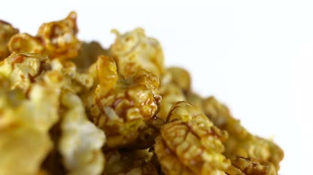 sprite : Caramel popcorn rotates on a white background. Super close up shot Stock Footage