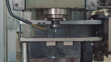 Changing the drill at the CNC drilling machine Stock Footage
