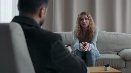 counselling : Woman Sitting On Sofa Talking To His Therapist