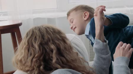 foster : Mom and son are fooling around on the couch Stock Footage
