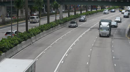 reconhecimento : Hongkong, China - August 2019: hd CCTV footage of city urban freeway road with driving cars. speed control electronic surveillance. camera with facial recognition technology on the street recording traffic flow. Vídeos
