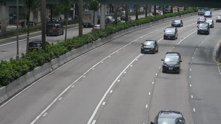 щит : Hongkong, China - August 2019: hd CCTV footage of city highway road with driving cars. speed control electronic surveillance. camera with facial recognition technology on the street recording traffic flow. Стоковые видеозаписи